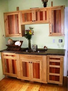 Reduce, reuse, recycle...rethink...  These kitchen cabinets are made from wooden pallets...yup, pallets! It's hardwood that otherwise was meant to be disposable. But sand it down & you have beauty to work with!