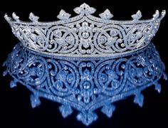 THE TIME CAPSULE. Tiara. 1910, France. The tiara of Countess Edwina Mountbatten was made from diamonds and set in solid platinum. Scroll and trefoil motifs surround the intricate design.