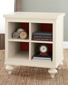 Ikea hack...take the bookshelf part of your Ikea Expedit desk and bookshelf combo and add a flat shelf on top and bun feet on bottom OR add crown on top and base molding at the bottom. It will dress it up!
