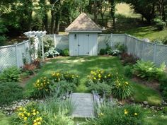 """one of the side yards.  the lattice fencing, small pergola, and small building.  called """"secret garden"""" by Slater Associates Landscape Architects on houzz.com"""