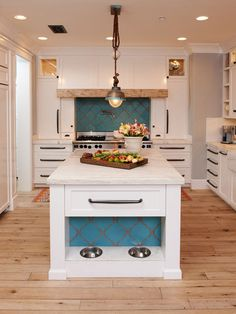 eclectic kitchen by Intimate Living Interiors - turquoise arabesco tile on backsplash and pet food center in island, Wolf range, Rohl sink