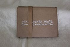 hand crafted Flower/Dot Card Set ... kraft with white ink ... looks like folkloric stamp or stencil ... found on Etsy ...