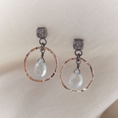 Okay, the most comfortable earrings I own are made by Anna Whitmore.  She uses sterling and 14k gold, and her earrings feel so great.