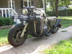 This 1984 Honda Goldwing was built for the 2011 show season. Designed and built for Dillon Shoffner in Maple Hill, KS by Garrett Larson of Show Stoppers Studio. This bike has full spinning gatling guns(fabricated from scratch), Rivetted tank, Jerry Can lid, Ammo boxes, and other us army items