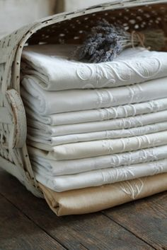 * A basketful of lovely monogrammed linens - what luxury!