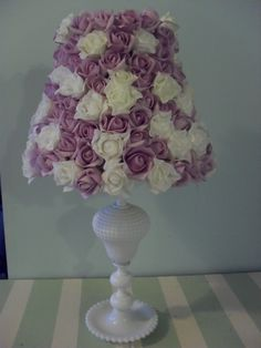 I am so doing this for my craft desk lamp. I have the perfect paper roses in my stash to create this. Weekend project for sure!!