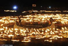 Amateur Vikings process around their longboat during the annual Up Helly Aa festival in Lerwick, Shetland Islands, Scotland