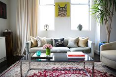 Peek Inside An Interior Designer's Crazy-Beautiful Chelsea Pad  #refinery29  http://www.refinery29.com/chelsea-apartments#slide1  Michele purchased her smoke glass and chrome coffee table from 1stdibs in Washington.