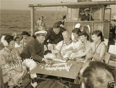 """Robert Ripley of """"Believe It Or Not"""" fame playing mah jongg on his yacht. Print for sale on ebay."""