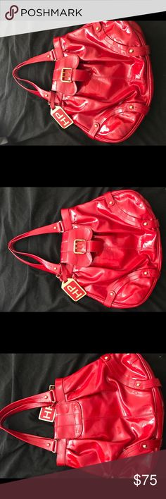 Hayden Panettiere Dooney and Bourke Purse This limited edition red leather purse is the brainchild of Hayden Panettiere and Dooney & Burke. It made out of real leather and is a gorgeous fire engine red that will instantly draw attention to you. The inside of this bag does show a bit of wear but you'd never know it from the outside! Dooney & Bourke Bags Shoulder Bags