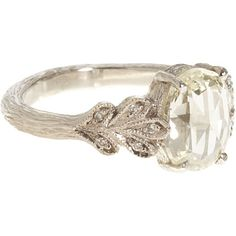 This is a really beautiful vintage engagement ring. :]
