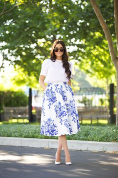 I also like the shape of this outfit and gives the body an interesting proportion.  The length of the sleeves are nice and the top itself has a nice shape.  I like how it can be paired with a skirt to be more dressed up or I can see it paired with jeans or shorts to be more casual too.  I usually don't like prints but this one is clean and feminine.