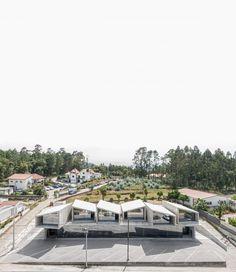 Architecture studio Summary built VDC, a modular housing scheme in Portugal's Vale de Cambria, out of prefabricated concrete elements.