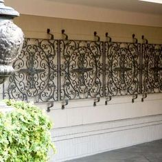 love the wrought iron wall hanging Wrought Iron Wall Decor, Metal Wall Decor, Patio Plants, Landscaping Plants, Classic Elegance, Metal Walls, Curb Appeal, Mountain Brook, Backyard