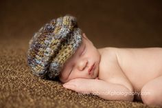 Cutest little hat ever anyone?! This little driving cap is made with a soft variegated yarn that works up so beautifully! It is playful and fun and