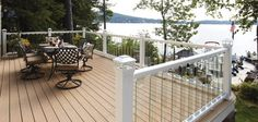Deckorators Clear Frontier glass balusters with white aluminum rail and white solar post caps