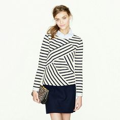 J. Crew Diagonal Long-Sleeve Sailor Top How's this for a new slant on the sailor top? J. Crew designers refashioned the crisp stripes you know and love in a diagonally seamed pattern, for an unexpected take on the piece. Navy and cream stripes. Slim fit. 100% cotton. Retail line not factory. NWOT   NO TRADE/HOLD/PP J. Crew  Tops Tees - Long Sleeve