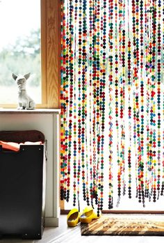 Nr. 1 on my to do list! Curtain made of little felt balls. Such a happy feeling and I love all the different colors!
