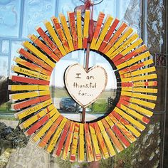 "Make it: Paint your clothespins, and once dry, attach them around a wire wreath frame. Cut a heart out of thick cardstock and attach to the center of your wreath. Write, ""I'm thankful for..."" on the heart, and then have your kids customize each clothespin with a different moment of gratitude."