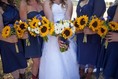 sunflower bouquets for a western ranch wedding, oh yes but with purple dresses