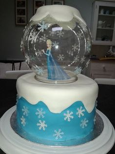 Frozen cake with snow globe centre piece. Using the right round vase you could do this for lots of items, goldfish bowl etc
