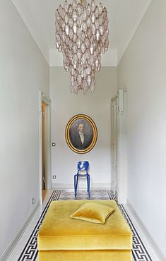 The Milan apartment of designer Ernesto Pigni...love the chandelier here and in the sconce in the bathroom shot