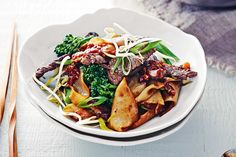 Charred beef and rice noodles. With a hint of sweetness and a touch of spice, this speedy beef and noodle stir-fry can be on the table in no time. Green it up with crunchy broccolini and bean sprouts, then finish it with a fiery chilli sambal.