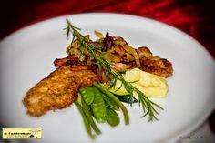 Schnitzel met bacon, ui en champignons
