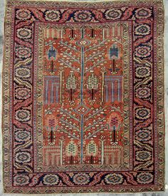 View 1: The field pattern of this rare small Goravan carpet is based on a Persian garden theme, with a tall, light blue leafy chenar tree (Oriental Plane Tree) acting as a central axis. Around it are right angled weeping willows and small cypresses. These three trees are essential to any traditional Iranian garden. The rust field is from natural madder root,the blues from indigo and the yellow from weld or another local dye plant. The deep azure main border displays a simple unelaborated…