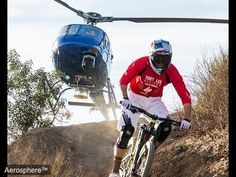 Mountain Biker v. Helicopter:  The bike has Nap of the Earth technology as standard, but thats a AS350B2 following. This could be too close to call...