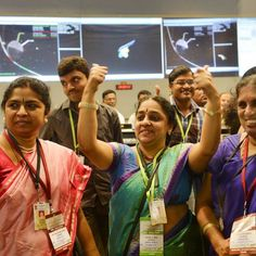 India's low-cost mission to Mars enters the red planet's orbit on its first attempt, a world first for space exploration.