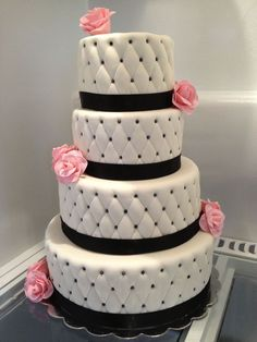 Black and white wedding cake with pink roses..