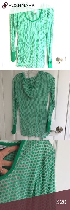 Prana polka dot green long sleeved top Prana polka dot green long sleeved top - sheer material and would need something underneath.  Here's your chance to show off your bandeau!   Top comes with hoodie, solid green banding at sleeve, and ties on one side for some side ruches.   Not one of prana's workout or post workout shirts but for more for style Prana Tops Tees - Long Sleeve