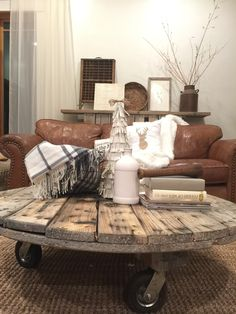 Rustic reclaimed wood coffee table, spool style. This is beautiful!
