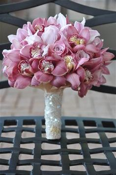 pink cymbidium and Rose wedding flower bouquet, bridal bouquet, wedding flowers, add pic source on comment and we will update it. www.myfloweraffair.com can create this beautiful wedding flower look.
