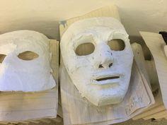 Y13 beginnings of Masks of Emotion, plaster gauze, on plastic masks as molds.