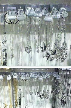 Flat Bar Merchandisers spanning wall mounted uprights, outfitted should-to-shoulder with saddle-style 90 degree tip Display Hooks create a mass jewelry… Jewelry Hooks, Silver Jewelry, Close Up, Ceiling Lights, Display, Bar, Style, Billboard, Silver Decorations