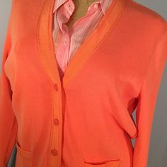 """Talbots Tangerine Button down Sweater Tangerine Button down sweater with matching ribbon outlining front & neckline & 2front pockets. V neck front. 5 buttons down front. Length from shoulder to bottom of sweater 24"""". Bust 40"""". 100% cotton Talbots Sweaters Cardigans"""