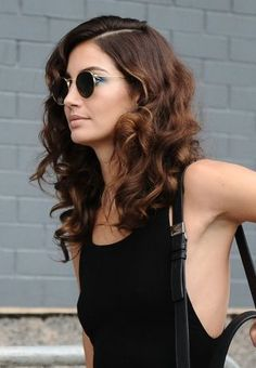 Lily Aldridge's tight curls prove that nothing goes better with ringlet curls than a deep side part on dark, medium length hair. It's science.