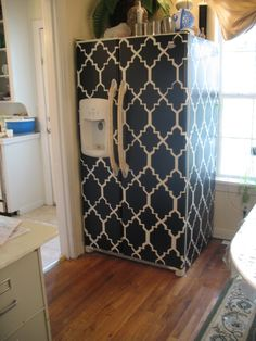Ugly old fridge? Cover it! A cheap way to remodel using contact paper! Totally would do that with wood style paper!