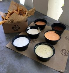 Hand cut fries and dipping sauces, D-Luxe burger