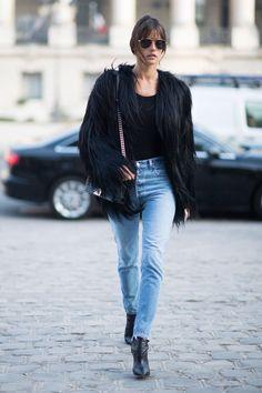 Alessandra Ambrosio pulls a Kate Moss at Paris Fashion Week.