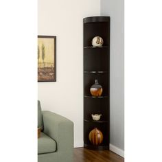 "Corner 5-shelf Display Stand. Mfr Model # ID-10370C. @Overstock.com.com. ◾Frame materials: Wood, MDF, veneer ◾Finish: Coffee bean ◾Number of shelves: Five ◾Shelves work for storage and display ◾Space-saving unit designed to fit in corner spaces ◾Dimensions: 12"" wide x 12"" deep x 77"" high ◾Height between each shelf: 12.5"" ◾Shelf depth: 11"""