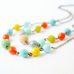 I found this really awesome Etsy listing at https://www.etsy.com/listing/102162956/multi-strand-colorful-beaded-necklace