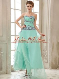 Apple Green Appliques and Ruched Bodice For Ankle-length Prom Dress  http://www.fashionos.com  The elegant strapless apple green prom gown features a sweetheart neckline bodice and a fully ruched bodice. The bodice part is accented with regular appliques to achieve a stunning effect. A soft tulle fabric skirt flows freely to the ankle, creating a dramatic look. Ruched bodice and zipper up back emphasize your slim curves. The dress is perfect for any occasion.