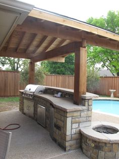 Wonderful Wooden Awning Pillars And Plafond Also Modern Bull Outdoor Gourmet-Q Grilling Island With Built-In Grill With Outdoor Blue Pool As Decor Outside Kitchen With Wooden Fences Design