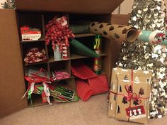 DIY wrapping station out of a moving box! Genius idea to stay organized and make wrapping presents a breeze!