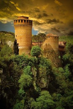 Medieval Fortress of Brisighella, Emilia Romagna, Italy | Originally built of gypsum rock in 1228. In the 14th century Manfredi, Lords of Faenza, built a bigger castle and 200 yrs. later the Venetians conquered it and gave the castle its present look.