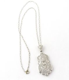 Vintage 14K White Gold Filigree Diamond Necklace This intricate filigree pendant is set with 3 diamonds. The center is set in a square of gold and is