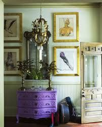 purple decor - love the unexpectedness of the purple dresser!